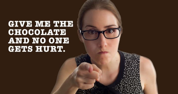 "angry woman pointing at screen with the words ""give me the chocolate and no one gets hurt"" next to her - to your health nutrition"