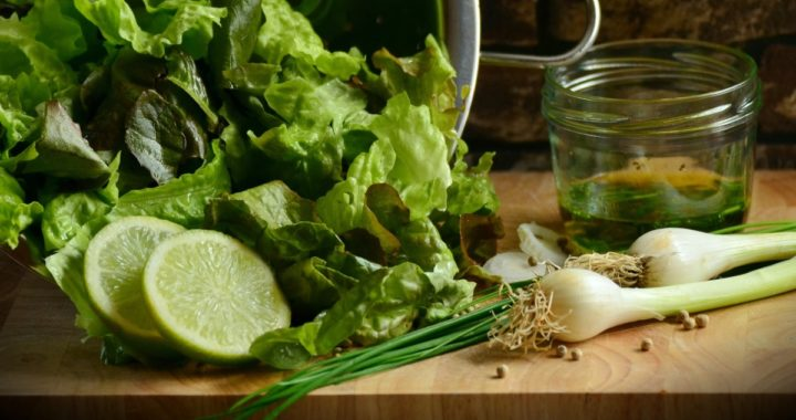 lettuce, limes, and green onions on a board - to your health nutrition